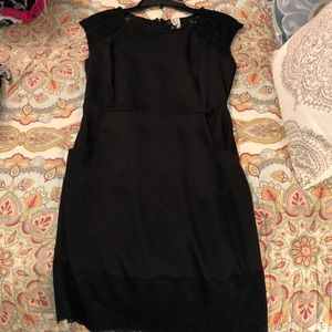 Black knee length with pockets and lace shoulders